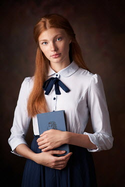 Alexander Vinogradov GIRL STANDING WITH RED HAIR HOLDING BOOK Women