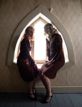 Elisabeth Ansley TWO RETRO WOMEN SITTING IN WINDOW Women