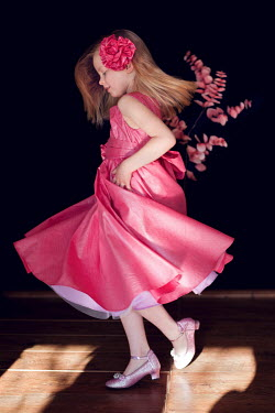 Magdalena Wasiczek YOUNG GIRL IN PINK PARTY DRESS DANCING Children