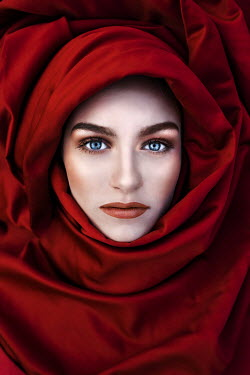 Marko Nadj CLOSE UP OF WOMAN IN RED SHAWL FROM ABOVE Women