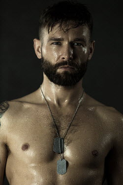 Magdalena Russocka man with bare torso wearing dog tags Men