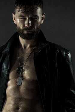 Magdalena Russocka modern man with bare torso in leather jacket and dog tags