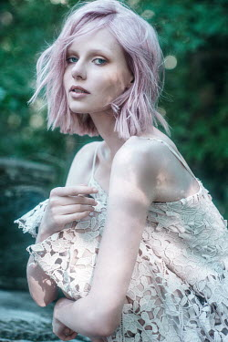 Maria Yakimova WOMAN WITH PINK HAIR IN LACY DRESS OUTDOORS Women