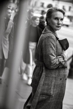 Maria Yakimova WOMAN IN TWEED COAT WALKING IN CITY STREET Women