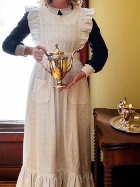 Elisabeth Ansley Maid holding tea pot