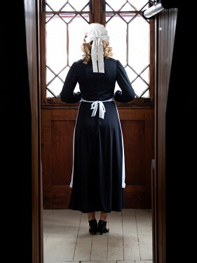Elisabeth Ansley Maid waiting by door
