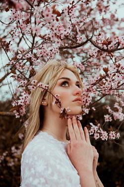 Greta Larosa Young woman under cherry blossom tree Women