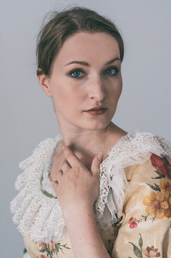 Jaroslaw Blaminsky CLOSE UP OF WOMAN IN LACY FLORAL DRESS Women