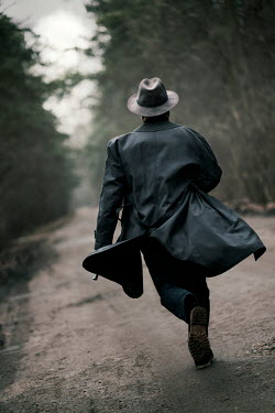 Jaroslaw Blaminsky MAN IN HAT RUNNING IN COUNTRY ROAD Men