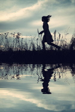 Magdalena Russocka silhouette of teenage girl running by river Women
