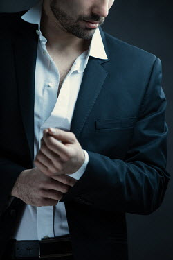 Magdalena Russocka close up of man in suit and unbuttoned shirt