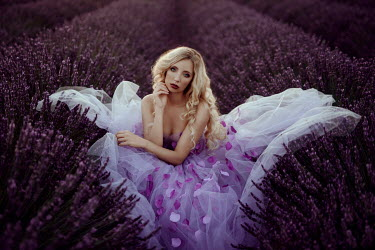 Nathalie Seiferth Young woman wearing dress with purple petals in lavender field