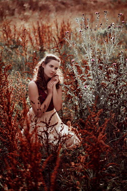 Nathalie Seiferth Young woman sitting in long grass