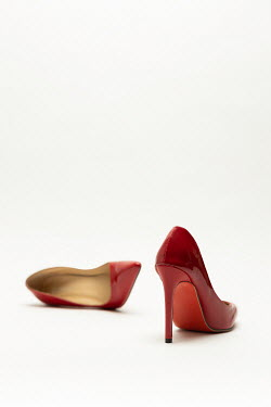 Paolo Martinez Red high heels on white background