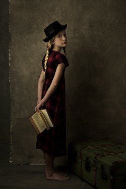 Robin Macmillan Girl in hat and red dress holding book behind her back