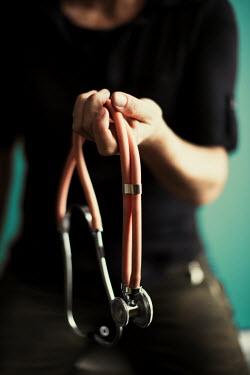 Robin Macmillan Hand of doctor holding stethoscope