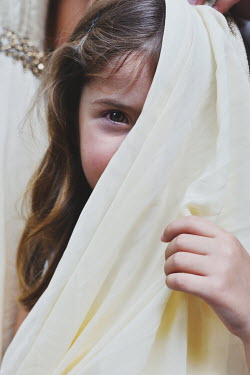 Tanya Gramatikova Girl hiding behind her mother's dress