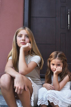 Tanya Gramatikova Sisters sitting on step