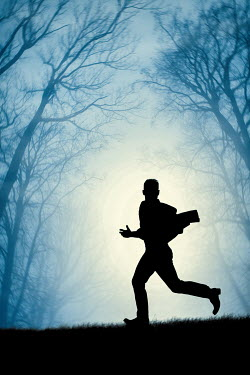 Magdalena Russocka silhouette of modern man running in woods