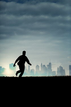 Magdalena Russocka silhouette of modern man running on hill with cityscape