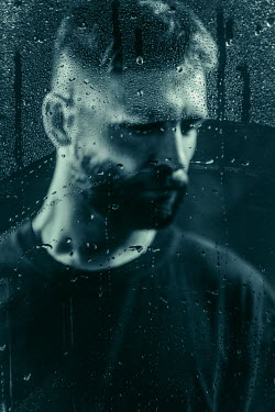Magdalena Russocka close up of sad man behind wet glass