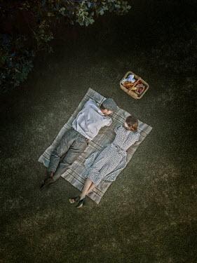 Mary Wethey Vintage couple lying on picnic blanket