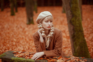 Nathalie Seiferth Young woman with braided hair and beret in park during autumn