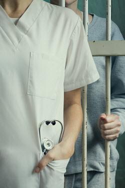 Robin Macmillan Doctor and prisoner behind bars