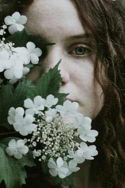 Alina Zhidovinova FACE OF BRUNETTE GIRL COVERED WITH WHITE FLOWERS Women