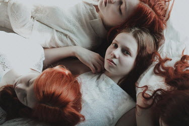 Alina Zhidovinova GROUP OF GIRLS IN WHITE WITH RED HAIR FROM ABOVE Groups/Crowds