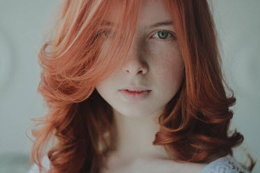 Alina Zhidovinova CLOSE UP OF SERIOUS GIRL WITH RED HAIR AND FRECKLES Women