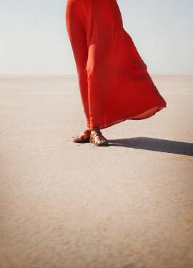Buffy Cooper WOMAN IN RED DRESS STANDING IN DESERT Women