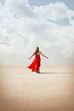 Buffy Cooper WOMAN IN RED DRESS WALKING IN DESERT Women