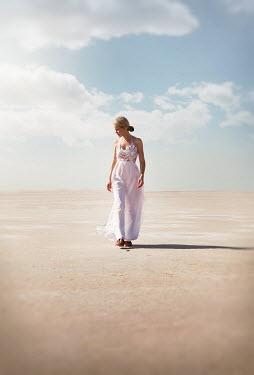 Buffy Cooper BLONDE WOMAN IN WHITE WALKING IN DESERT Women
