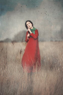 Anna Buczek DAYDREAMING WOMAN IN RED IN FIELD Women