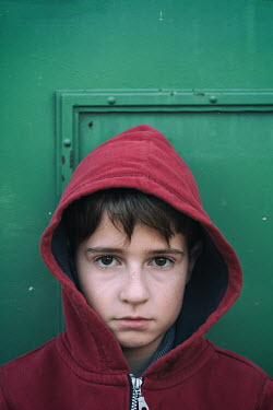 Galya Ivanova SAD YUONG BOY IN RED HOODIE OUTDOORS Children