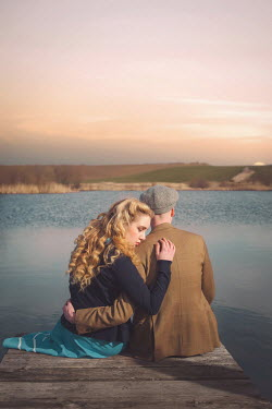 Joanna Czogala RETRO COUPLE HUGGING ON JETTY BY LAKE Couples
