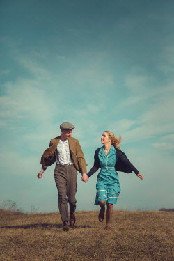 Joanna Czogala HAPPY COUPLE HOLDING HANDS IN COUNTRYSIDE Couples