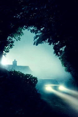 Lee Avison mysterious vehicle driving away from a house at night in silhouette