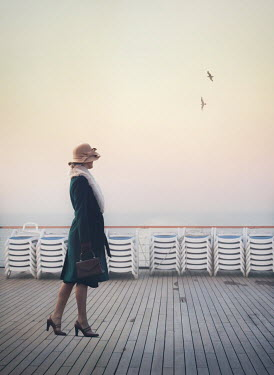 Mark Owen WOMAN WALKING ON DECK OF SHIP WATCHING SEA Women