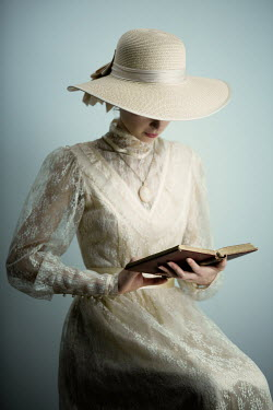 Magdalena Russocka historical woman in lace dress and hat reading book