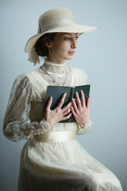 Magdalena Russocka historical woman in lace dress and hat holding book