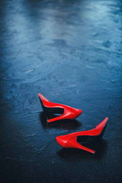 Magdalena Russocka red stilettos lying on frozen pond