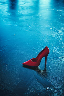 Magdalena Russocka red stiletto shoe on frozen pond