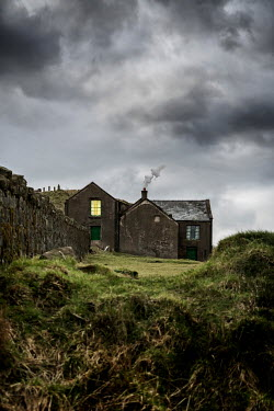 Stephen Mulcahey OLD FARMHOUSE WITH LIGHT IN BEDROOM Houses