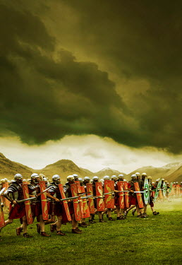Stephen Mulcahey ROMAN ARMY MARCHING IN STORMY COUNTRYSIDE Groups/Crowds
