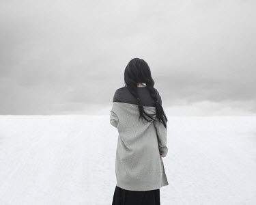 Patty Maher GIRL WITH DARK HAIR IN SNOWY FIELD FROM BEHIND Women