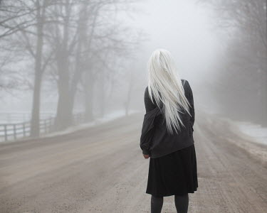 Patty Maher GIRL WITH WHITE HAIR ON WINTRY COUNTRY ROAD Women