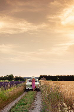 Ysbrand Cosijn WOMAN BY CLASSIC CAR IN SUMMERY LANDSCAPE Women