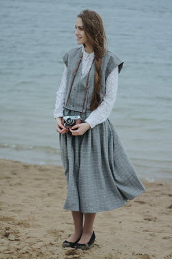 Alina Zhidovinova SMILING GIRL WITH CAMERA ON SANDY BEACH Women